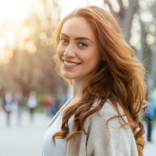 Young female patient smiling about cosmetic dentistry in Seattle, WA
