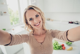 Someone taking a selfie to demonstrate to patients how to submit a selfie