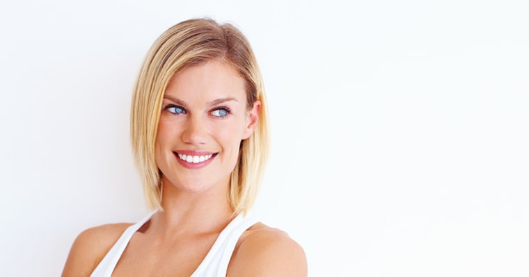 Blonde woman smiling after teeth whitening at Love Your Smile